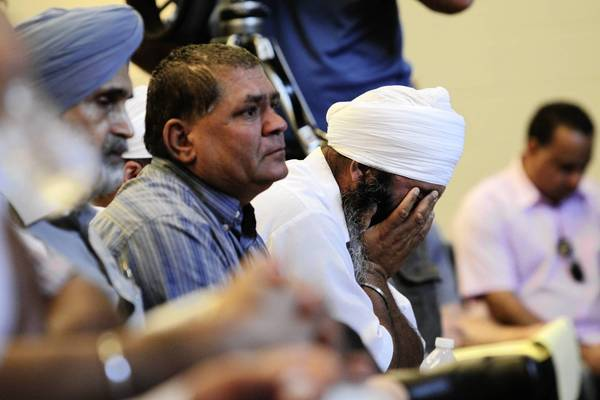 Members of the Sikh community attend a press conference held by the Sikh Temple at the Salvation Army Centennial Corps Community Center in Oak Creek, Wis.