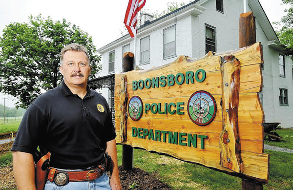In this 2009 file photo, Boonsboro Chief of Police Jeff Hewett stands in front of what was then the new home of the Boonsboro Police Department. Hewett is retiring Dec. 1 after seven years on the job.