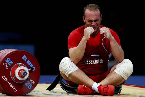 Ruslan Nurudinov of Uzbekistan cries after  failing a lift in the men's 105kg Group A weightlifting clean and jerk competition at the ExCel venue during the London 2012 Olympic Games.