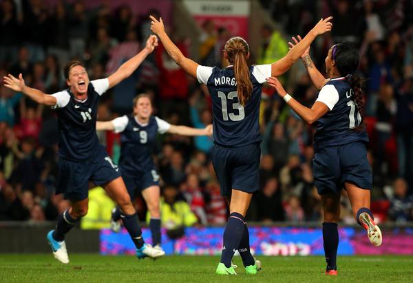 American women celebrate goal in overtime Monday
