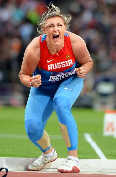 Russia's Evgeniia Kolodko screams after winning the bronze medal in the shot put.