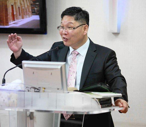 "South Korean Pastor Kim Sung-eun, 48, runs a small church that caters to a mixed congregation of South Koreans and North Korean defectors. ""Saving people is my No. 1 priority,"" he says."