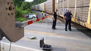 Two people were injured and a 3-week-old infant escaped injury Monday evening after the car in which they were traveling was struck by a CSX train at the Tavern Road railroad crossing, according to police.