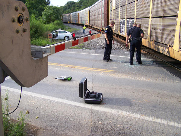 Martinsburg (W.Va.) Police Department officers investigate a crash involving a CSX train and a car at the Tavern Road/West Moler Avenue crossing in Martinsburg.