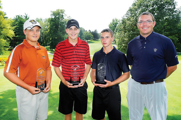 Champions in Monday's Tri-State Junior Golf Association Don Mowen Memorial, held at Fountain Head Country Club, were Karsen Rush (age 12-13) with a 71; Max Bell (14-15) with an 81 and winning a playoff; Ryan Mumaw (age 16-18) with a 73. At the right is Fountain Head assistant Paul Bedigian. The Tournament of Champions will be played Monday at Beaver Creek Country Club.