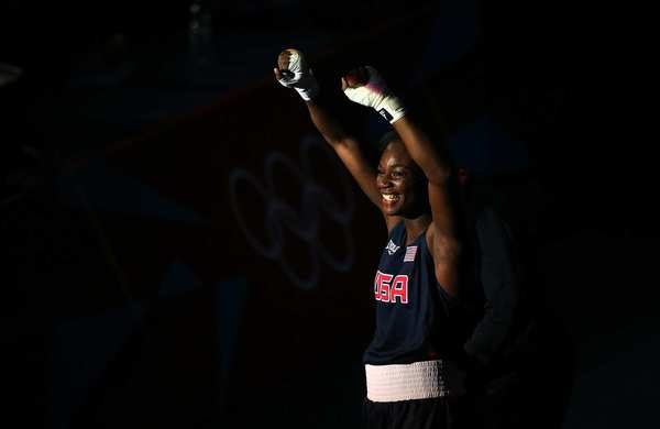 U.S. middleweight boxer Claressa Shields savors a win over Sweden's Anna Laurel in a quarterfinal women's boxing match.