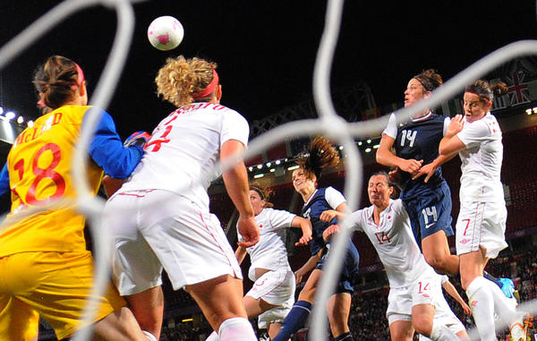 U.S. forward Alex Morgan, fourth from left, heads the ball into the net for the winning goal against Canada during the London 2012 Olympic Games.