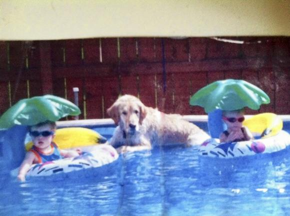 The Sparks twins at age 1 spend some quality time with dog Chip in a family photo.