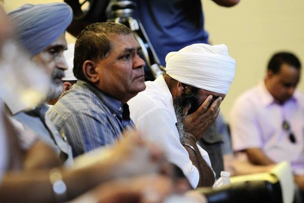 Members of the Sikh community attend a Monday news conference held by the Sikh Temple of Wisconsin, where a gunman killed six people Sunday before police fatally shot him.