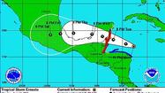 An up-and-down Tropical Storm Ernesto is forecast to strengthen into a hurricane by Tuesday and take aim at Belize or Mexico's Yucatan with sustained winds of 85 mph.