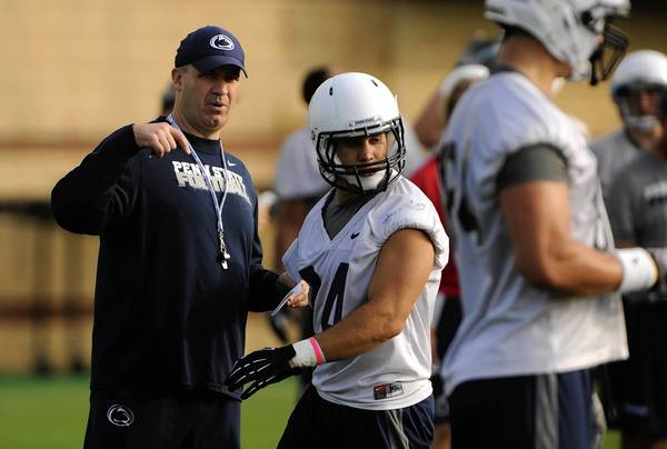 Penn State head football coach Bill O'Brien works with Derek Day and the rest of his team during the first day of football practice on Monday.
