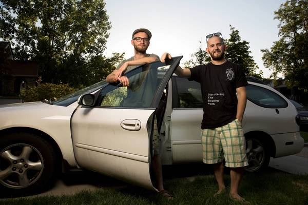 "Cancer survivors Evan Bartlett, right, and Eli Accola are traveling around the U.S. filming on their documentary, ""Discovering the Beating Path."""