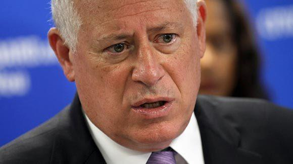 Gov. Pat Quinn talks to reporters after signing consumer protection legislation in July.