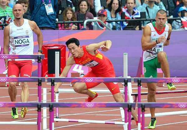 China's Liu Xiang falls while competing in the men's 110-meter hurdles heats.