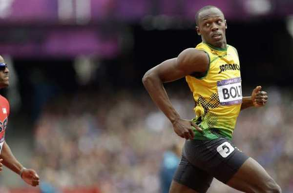 Usain Bolt competes in a men's 200-meter heat Tuesday.