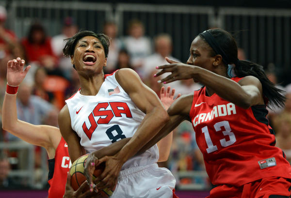 Team USA guard Angel McCoughtry (left) vies with Canadian forward Tamara Tatham during their women's quarterfinal Tuesday.