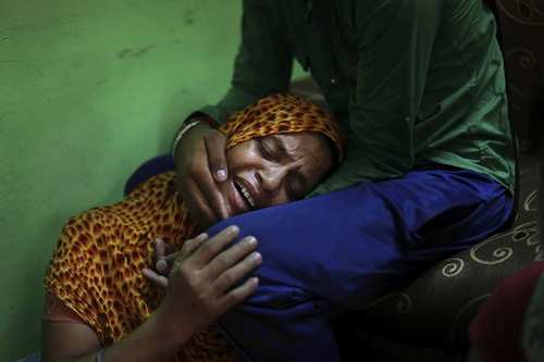 Lokinder Kaur, whose husband, Ranjit Singh, was killed in the shooting attack at a Sikh temple in Wisconsin, mourns at the family home in New Delhi on Tuesday. Singh, one of six killed in a shooting attack on the temple, never came home to India even once in 16 years, working at a grocery store during the week and volunteering at the Sikh gurdwara on weekends. He promised his family he was doing what had to be done to get a green card so they could come join him.