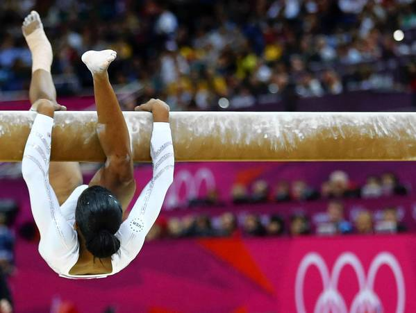 Gabrielle Douglas of the U.S. falls as she competes in the Women's Gymnastics balance beam final in the North Greenwich Arena during the London 2012 Olympic Games.