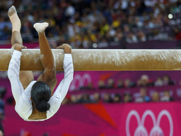 Gabrielle Douglas of the U.S. falls as she competes in the women's gymnastics balance beam final.