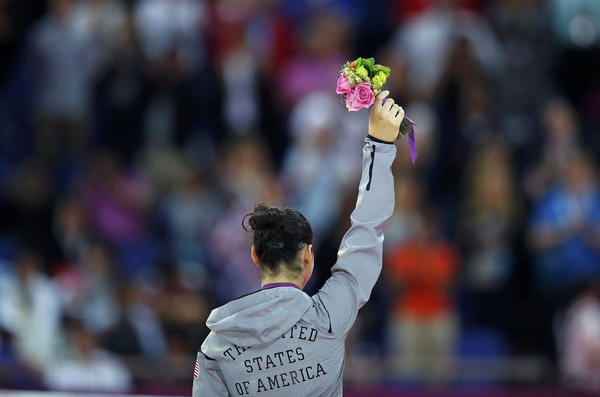 Alexandra Raisman of the U.S. celebrates winning a bronze medal in the women's gymnastics balance beam.