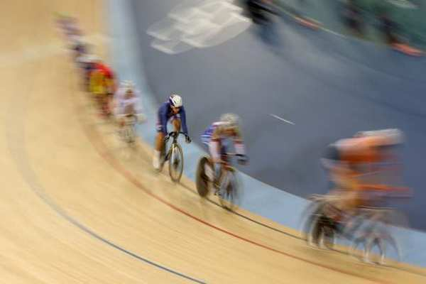 Sarah Hammer, center, of the U.S. competes in the women's omnium 10-kilometer scratch race.