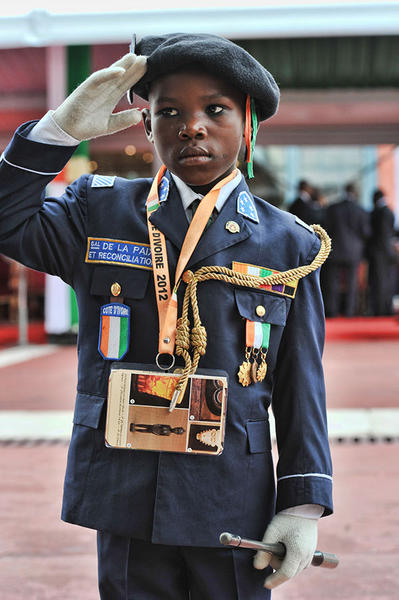 An Ivorian boy stands on August 7, 2012 outside the presidential palace in Abidjan during celebrations marking the 52nd anniversary of the country's independence from France. Ivory Coast's government on August 7 accused fighters loyal to ex-President Laurent Gbagbo of perpetrating deadly attacks on August 6 that killed 10 soldiers and rattled fragile reconciliation efforts.