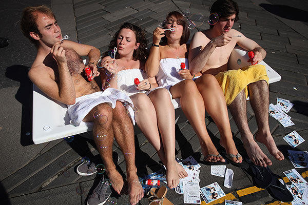 Street entertainers sit in a bath tub and blow bubbles as they perform on the Royal Mile to promote their shows during in the Edinburgh Fringe Festival on August 7, 2012 in Edinburgh, Scotland. The Edinburgh Festival Fringe is the largest arts festivals in the world; established as an alternative to the International Festival also held in August, and celebrates it's 66th anniversary this year.