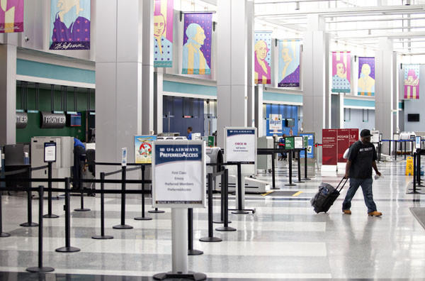 A passenger uses Newport News / Williamsburg International Airport in Newport News on Tuesday. Air travel is down for the area approximately 100,000 people. With the loss of AirTran it appears that fewer people are traveling by air in the area.
