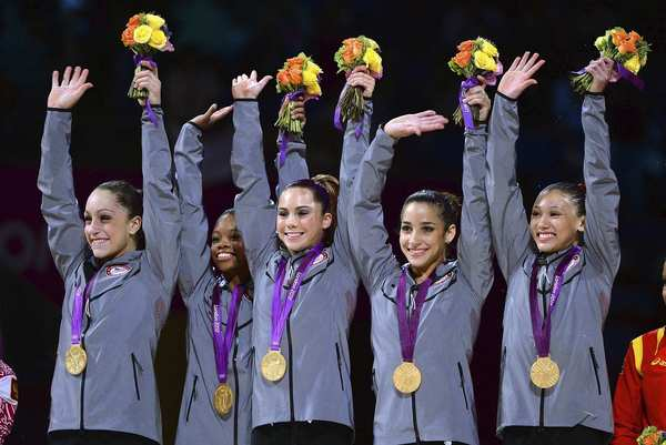 The jubilant U.S. gymnastics team members, from left: Jordyn Wieber, Gabrielle Douglas, McKayla Maroney, Alexandra Raisman and Kyla Ross.