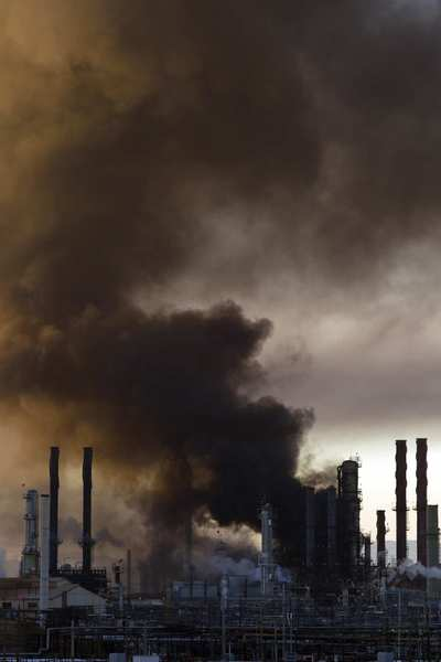 Smoke billows from a crude oil unit at the Chevron refinery in Richmond, Calif.