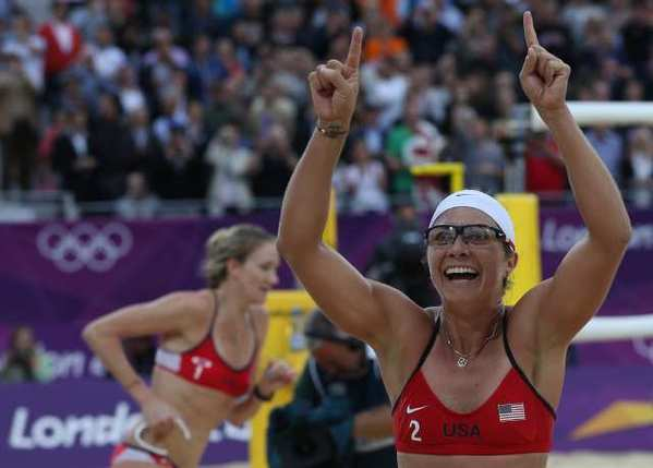 Misty May-Treanor, right, and Kerri Walsh-Jennings celebrate after defeating China in their semifinal women's beach volleyball match.