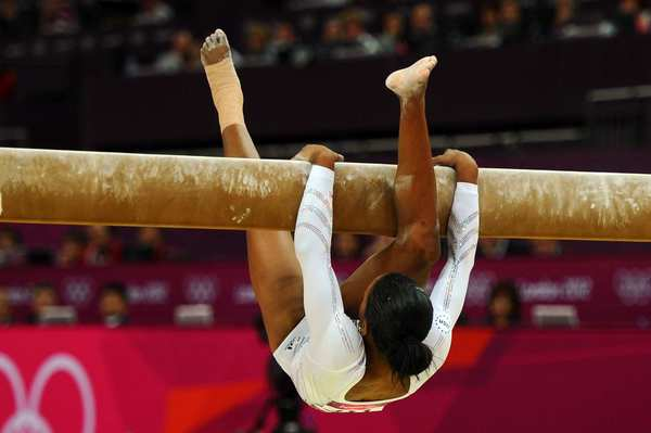 Gabrielle Douglas of the United States falls off the beam during the artistic gymnastics women's beam final.