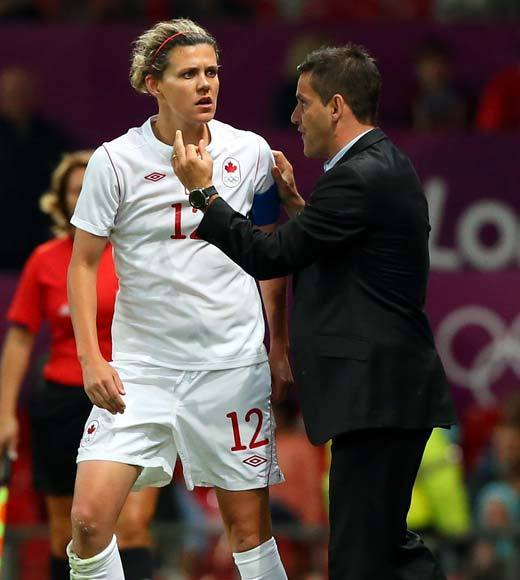 2012 Summer Olympics Best and Worst moments: Canadian soccer star Christine Sinclair and team coach Jon Herdman have both voiced their displeasure with the ref in the U.S./Canada semifinal calling a rare penalty of time-wasting on the Canadian goalkeeper, which led to a free kick. Then on the free kick, one of the Canadian players was struck in the arm by the ball when she could not get out of the way, which is a handball. A handball in the penalty area means a penalty kick, which Abby Wambach buried to tie the score 3-3.   The Canadians feel the game was taken away from them by the referee calling the rare penalty that eventually led to the goal. There has now been some speculation of suspensions for the bronze medal match for the people who have publicly complained about the refs. FIFA says in a statement, The FIFA Disciplinary Committee is currently analysing incidents that occurred after the conclusion of the match. Further information will be provided only after the Committee are in possession of all the elements of the case.  -- Andrea Reiher, Zap2it