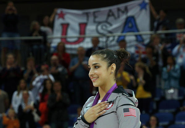 Alexandra Raisman of the U.S. celebrates winning a gold medal in the women's gymnastics floor exercise victory ceremony.