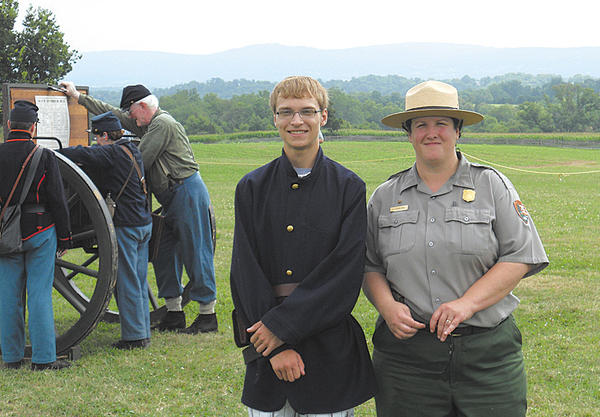 Eagle Scout Robert Calum Lunsford of Fairplay is shown with Ranger Christie Stanczak at Antietam National Battlefield, where he fired a cannon.