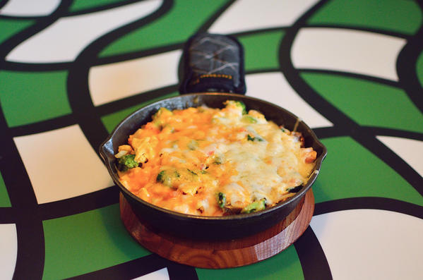 The Backpackers Pie at the Breakfast Shoppe has six farm fresh eggs, bacon, sausage, ham, spinach, onions,mushrooms, tomatoes, broccoli, homefries, sharp cheddar and jack cheeses?