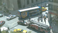 A Megabus that hit a 76-year-old woman, critically injuring her near Union Station this afternoon. Casey Hill, for the Tribune