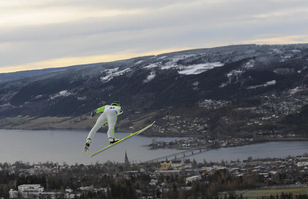 A skier floats over Lillehammer in southern Norway about 100 miles north of Oslo.