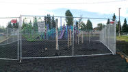 The Anchorage School District says arson is suspected in the playground fire Monday morning at Aquarian Charter School in Spenard.