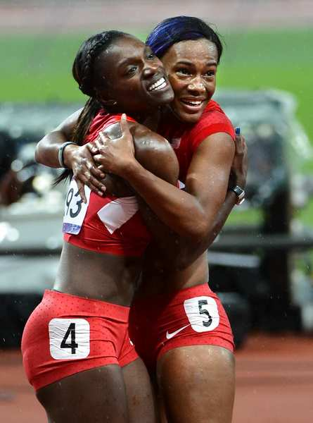 Kellie Wells, left, and Dawn Harber celebrate their  medals  in the 100-meter hurdles.