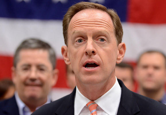 Sen. Pat Toomey speaks about jobs in a press conference at Cigars International Tuesday.