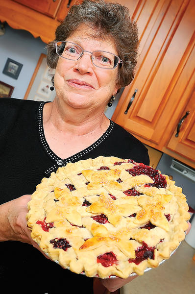 Janet Rohrer holds her grand champion-prize winning bumbleberry pie.
