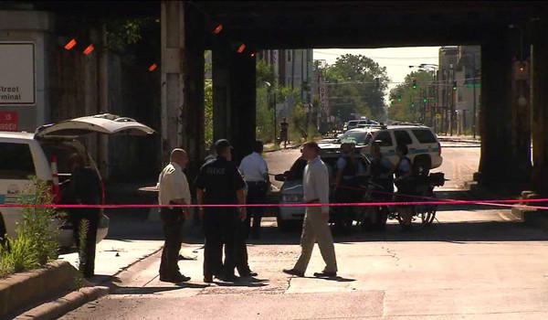 Police on the scene of a hit-and-run that killed a woman riding a bicycle on Monday.