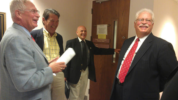 After making their pitch to the current county commissioners on Tuesday, former commissioners, from left, R. Lee Downey, Richard Roulette, Ronald Bowers and John Salvatore share a laugh.