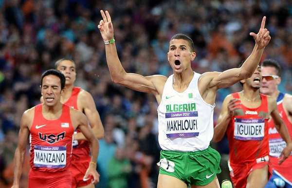 Algeria's Taoufik Makhloufi wins the gold medal in the 1,500-meters race.   Leo  Manzano of the United States picks up the silver medal.