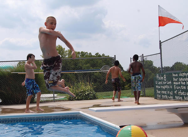 "Robert Maichle, 12, of Blue Ridge Summit, Pa., jumps into the pool at Camp Joy El in Antrim Township, Pa., on Tuesday. Robert is a camper in ""Camp Amp"" from Easter Seals."
