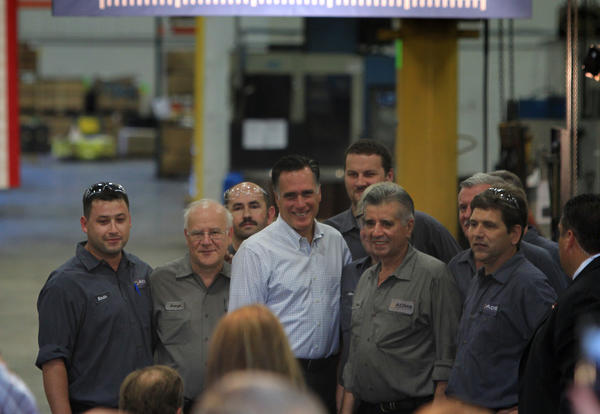 Republican presidential candidate Mitt Romney poses with a group of workers at Acme Industries in Elk Grove Village, Ill.