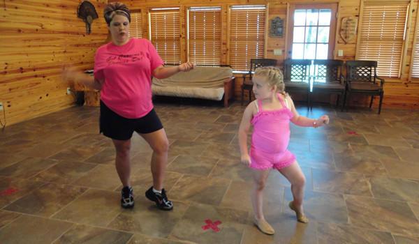 Alana Johnson practices with her dance coach, Amanda Carter.