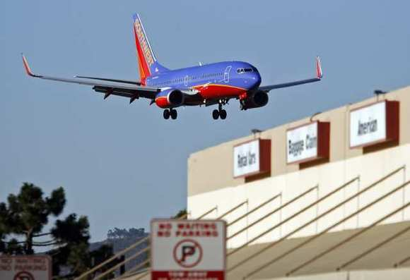 A Southwest airliner lands at Bob Hope Airport.