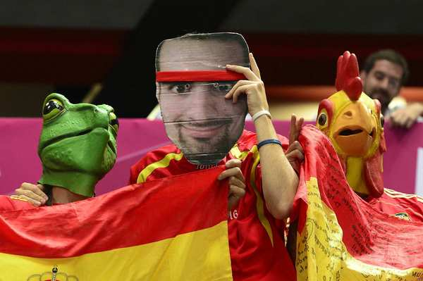 Disguised as Spanish fans, members of Spain's men's handball team found time to clown around before their preliminary group B handball match against Hungary at the London 2012 Olympics Games.